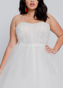 Gorgeous bridal gowns for all body shapes: plus size, curvy, or petite brides. Try on our wedding dresses at home. Size 0-30. Comfortable. Convenient. Fun. Lace or satin. Mermaid or A-line.  The Sarah Gown sweet and soft dot tulle over a sweetheart bustier and flowy, gathered A line skirt. For the bride who loves tulle without too much volume. Slightly curved neckline on this bustier updates a classic shape with sweet romance.