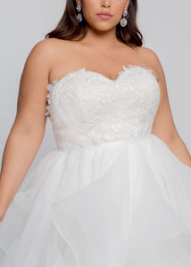 Gorgeous bridal gowns for all body shapes: plus size, curvy, or petite brides. Try on our wedding dresses at home. Size 0-30. Comfortable. Convenient. Fun. Lace or satin. Mermaid or A-line. We love the modern Ada Gown combining beautiful blush and ivory lace with a flowing and sophisticated organza skirt. The sweetheart neckline with ball gown skirt will flatter your waist and bust. Pair with a jeweled belt for added elegance.