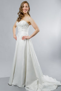 Gorgeous bridal gowns for all body shapes: plus size, curvy, or petite brides. Try on our wedding dresses at home. Size 0-30. Comfortable. Convenient. Fun. Lace or satin. Mermaid or A-line. Lace sweetheart top with snaps that allow you to customize even further by adding lace sleeves. Elegant A-line satin skirt that will twirl around with you and features an elegant chapel train. The waist of the skirt is adorned with a thick band that will cinch in the waist.