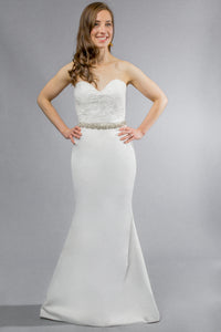 Gorgeous bridal gowns for all body shapes: plus size, curvy, or petite brides. Try on our wedding dresses at home. Size 0-30. Comfortable. Convenient. Fun. Lace or satin. Mermaid or A-line.  Sweet lace lends a romantic air to fitted satin, as the relaxed mermaid skirt carries the allure of the dress all the way to the floor. This sweetheart top, with its textured lace details, has hooks that allow you to customize further with the addition of sleeves.