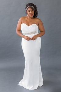 Gorgeous bridal gowns for all body shapes: plus size, curvy, or petite brides. Try on our wedding dresses at home. Size 0-30. Comfortable. Convenient. Fun. Lace or satin. Mermaid or A-line. This dress will undoubtedly flatter with the ruching on the top that brings in the eye and its hip-hugging skirt. Ruched chiffon sweetheart top, soft and supportive for your entire event. Soft satin mermaid skirt that will not fail to flatter your body.