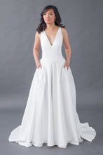 Load image into Gallery viewer, Whether you're a plus-size, curvy, or petite bride, Leigh & Siena can create your dream wedding dress. Our Home Try-On experience is convenient, customizable, and affordable. The soft satin will shine under any lighting, while the band of the skirt will bring in your waist and the v-neck top will elongate the body. The clean lines of this satin v-neck top are timelessly chic, while the thick straps are comfortable and supportive. Elegant A-line satin skirt that will twirl around with you.