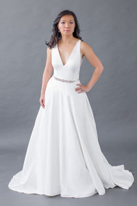 Whether you're a plus-size, curvy, or petite bride, Leigh & Siena can create your dream wedding dress. Our Home Try-On experience is convenient, customizable, and affordable. The soft satin will shine under any lighting, while the band of the skirt will bring in your waist and the v-neck top will elongate the body. The clean lines of this satin v-neck top are timelessly chic, while the thick straps are comfortable and supportive. Elegant A-line satin skirt that will twirl around with you.