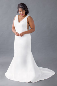 Gorgeous bridal gowns for all body shapes: plus size, curvy, or petite brides. Try on our wedding dresses at home. Size 0-30. Comfortable. Convenient. Fun. Lace or satin. Mermaid or A-line. The v-neck and sheer side panels will catch the eyes of your guests and the fit of the dress will let your features shine. The clean lines of this satin v-neck top are timelessly chic, while the thick straps are comfortable and supportive. Soft satin mermaid skirt that will not fail to flatter your body.
