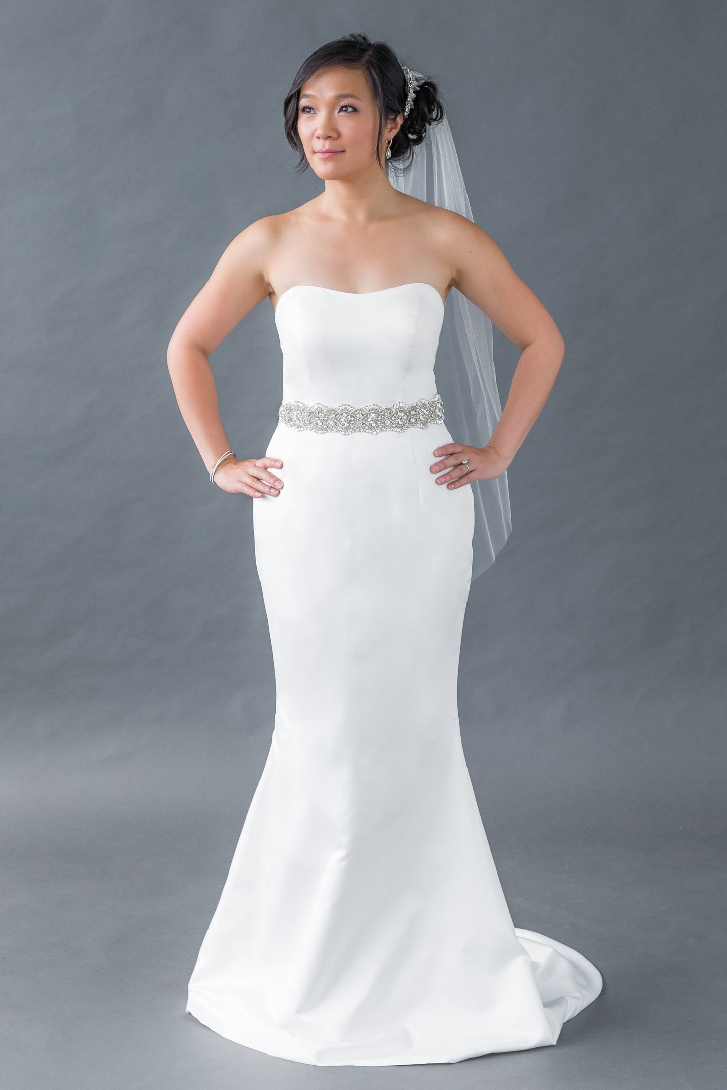Gorgeous bridal gowns for all body shapes: plus size, curvy, or petite brides. Try on our wedding dresses at home. Size 0-30. Comfortable. Convenient. Fun. Lace or satin. Mermaid or A-line. This strapless satin top has a simple semi-sweetheart neckline and design that allows you to pair anything with it. Soft satin mermaid skirt that will not fail to flatter your body. Style with a jeweled belt if desired.