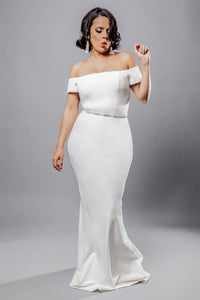 Gorgeous bridal gowns for all body shapes: plus size, curvy, or petite brides. Try on our wedding dresses at home. Size 0-30. Comfortable. Convenient. Fun. Lace or satin. Mermaid or A-line. The off-the-shoulder sleeves lend a modern, on-trend twist to the combination. This crepe off-the-shoulder top offers a graceful and poised look that will look beautiful paired with any skirt. The crepe sheath column skirt is elegant, shining, and will make your legs look as if they are miles long.