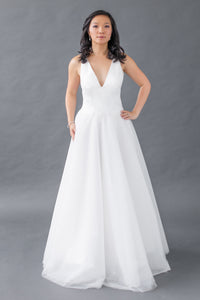 Gorgeous bridal gowns for all body shapes: plus size, curvy, or petite brides. Try on our wedding dresses at home. Size 0-30. Comfortable. Convenient. Fun. Lace or satin. Mermaid or A-line. The clean lines of this satin v-neck top are timelessly chic, while the thick straps are comfortable and supportive. Tulle A-Line skirt that offers a soft volume for increased interest and romance as you glide through your wedding.