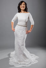 Load image into Gallery viewer, Gorgeous bridal gowns for all body shapes: plus size, curvy, or petite brides. Try on our wedding dresses at home. Size 0-30. Comfortable. Convenient. Fun. Lace or satin. Mermaid or A-line. This crepe bateau-neck top gives polish to any look and offers extra coverage with its three-quarter length sleeves. The lace fit and flare skirt has new details hidden in between each of its pleats.