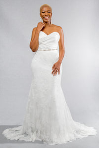 Gorgeous bridal gowns for all body shapes: plus size, curvy, or petite brides. Try on our wedding dresses at home. Size 0-30. Comfortable. Convenient. Fun. Lace or satin. Mermaid or A-line. This strapless sweetheart top complements any figure with its satin ruching. Hooks are available to further customize the dress with sleeves. This fit and flare skirt has a delicate eyelash lace hem that adds a stunning detail to any combination.