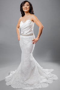 Gorgeous bridal gowns for all body shapes: plus size, curvy, or petite brides. Try on our wedding dresses at home. Size 0-30. Comfortable. Convenient. Fun. Lace or satin. Mermaid or A-line. This strapless sweetheart top complements any figure with its satin ruching. Hooks are available to further customize the dress with sleeves. This lace fit and flare skirt has new details hidden in between each of its pleats.