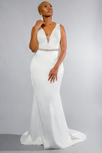 Gorgeous bridal gowns for all body shapes: plus size, curvy, or petite brides. Try on our wedding dresses at home. Size 0-30. Comfortable. Convenient. Fun. Lace or satin. Mermaid or A-line. Lace deep-v top with boning and exposed cups to support you from morning 'till night. Soft satin mermaid skirt that will not fail to flatter your body.