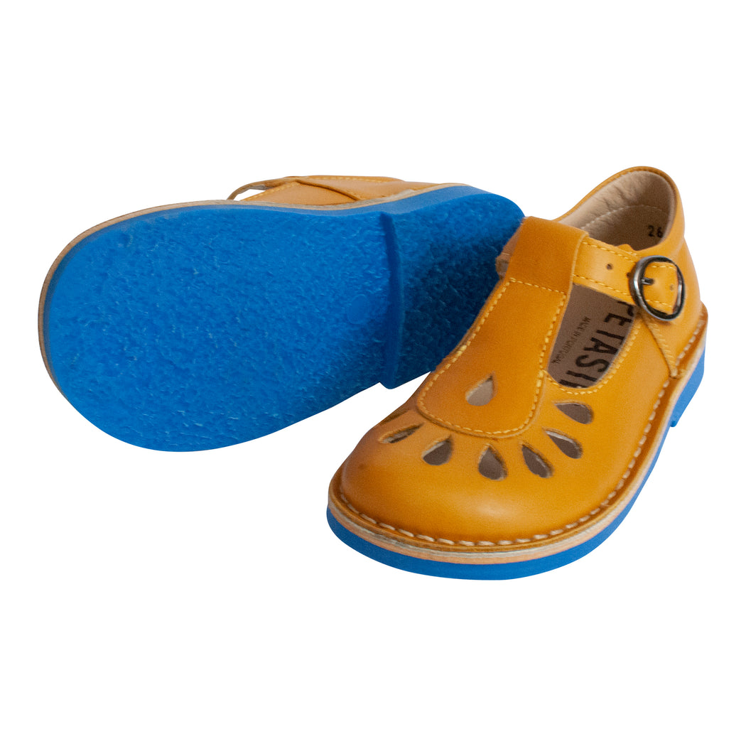 Mustard yellow leather classic T-bar shoe with teardrop cutout detail and buckle fastening. Made in Portugal by Petasil.