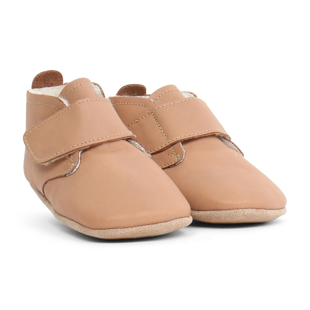 Bobux caramel leather soft sole high top desert boot with velcro fastening and merino lining.