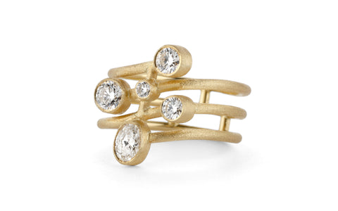 Contemporary spiralling ring made 18ct yellow gold with conflict free diamonds. Handmade in London.