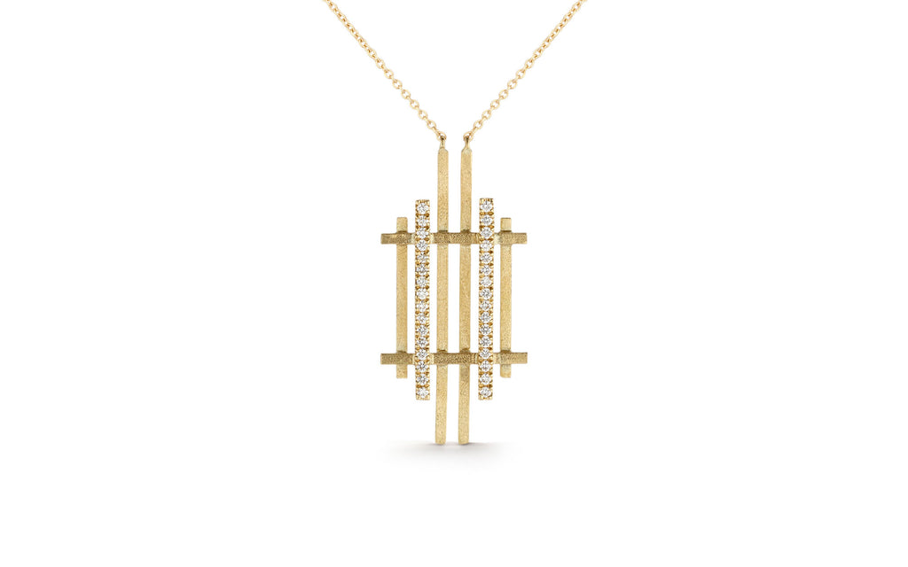 Handmade from lines of gold this geometric pendant is made from recycled 18ct yellow gold. Handmade in London.