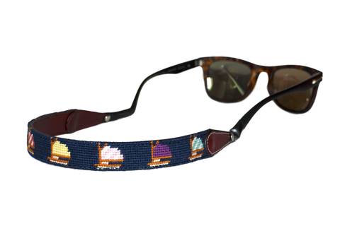 Asher Riley needlepoint sailboat on blue sunglass straps