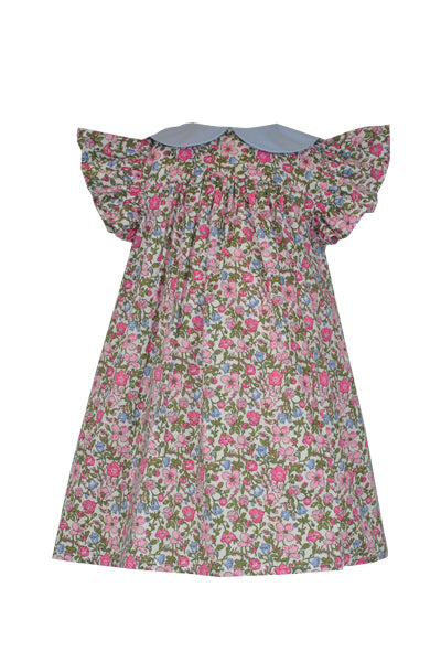 A sweet empire line dress in our pink & green ditsy Betsy print for this younger dress. A neat fitted top with wide frill sleeves and contr collar give the dress traditional elegance. Flowing into a gathered skirt, the lashings of net underskirts offer twirlability and fun. Fully lined for comfort, the dress is finished with a full button back for easy changing.   Team up with our Dorset collection for elegant Little Lady style.  Fabric: 100% cotton, Petticoats 100% polyester Machine Washable