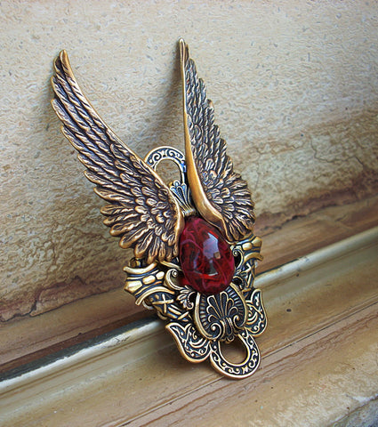 Brass Wings Ring with Red Glass