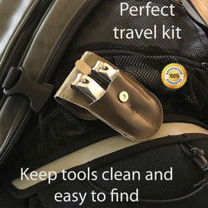 "fingernail clipper, toenail clipper, and nail file inside open brown case.  ""Perfect travel kit"""