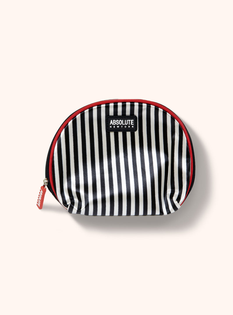 A rounded, satin makeup bag with monostripe design, a zipper, and red trimming along the stitching line.