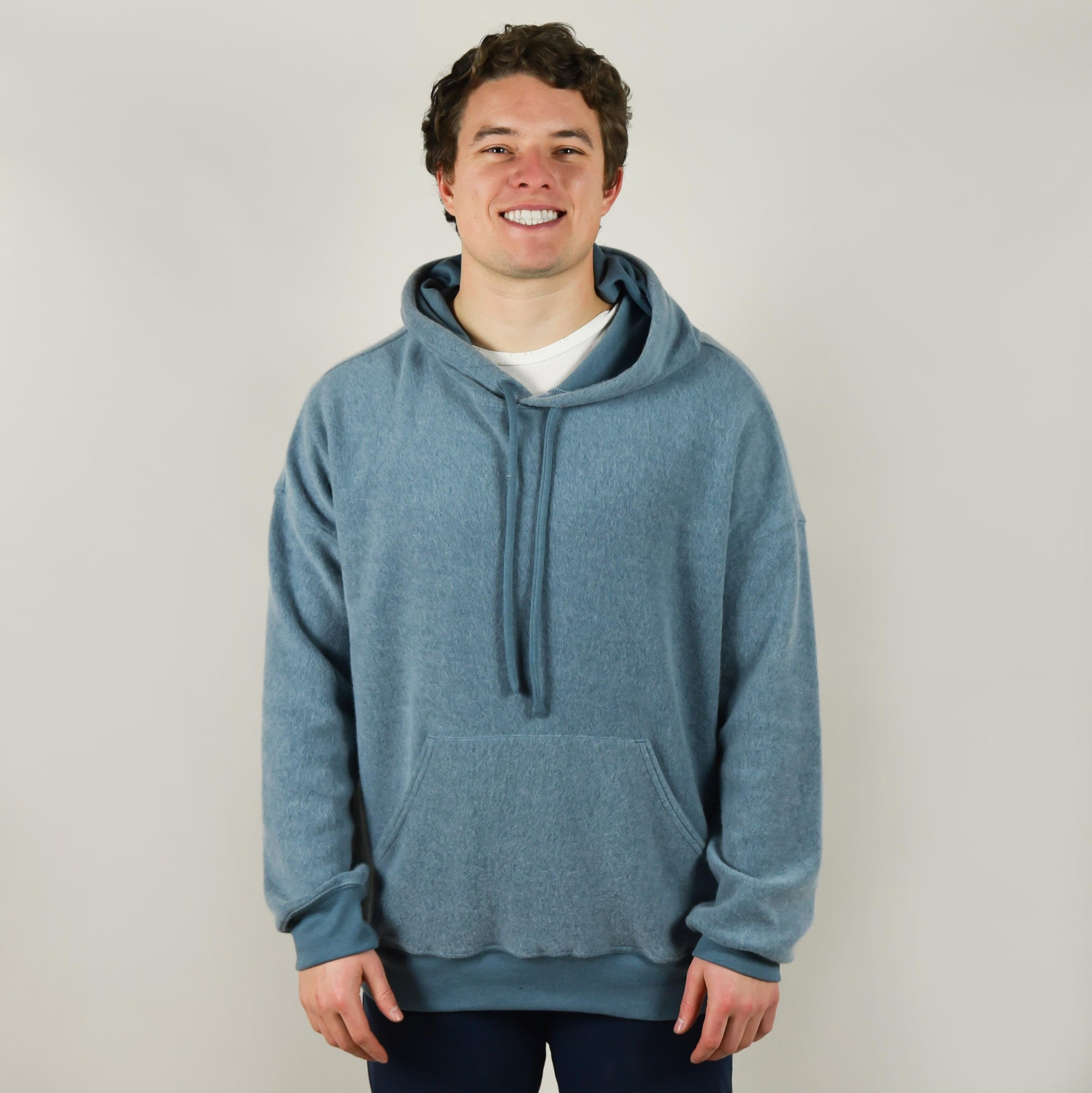 Model wearing Bella Canvas 3329 Sueded Fleece Pullover Hoodie