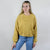 Model wearing Bella Canvas 7503 Women's Cropped Fleece Crew-Neck