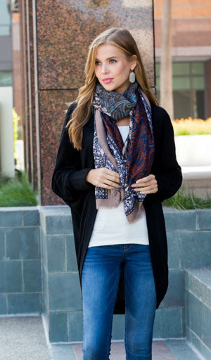 woman in gray cardigan and scarf