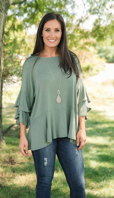 ruffled green top