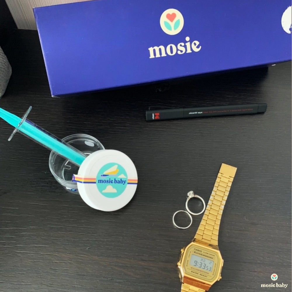 mosie kit and syringe with wedding rings