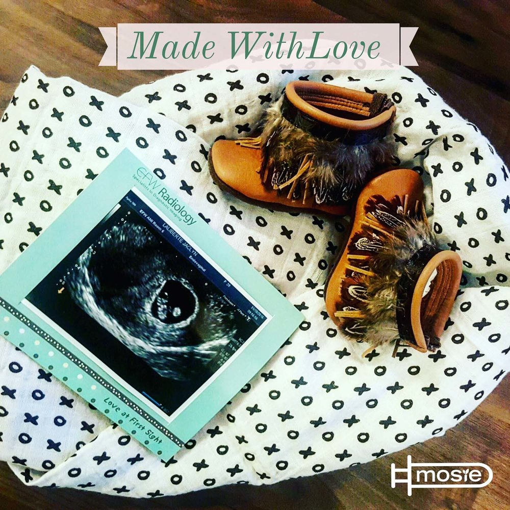 sonogram, baby blanket, and baby boots of a mosie baby