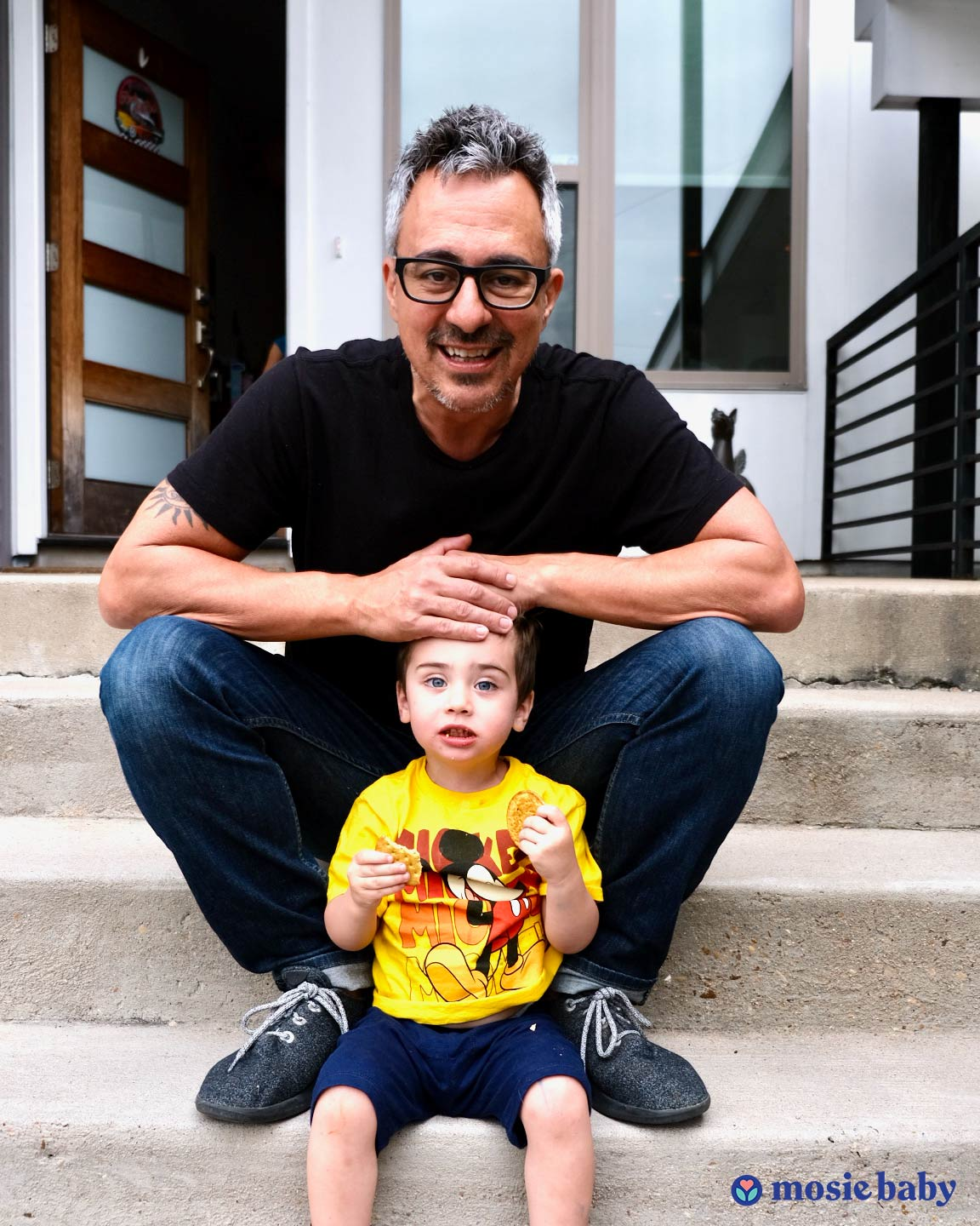 Mosie Baby co-founder Marc Brown and his son sitting on steps