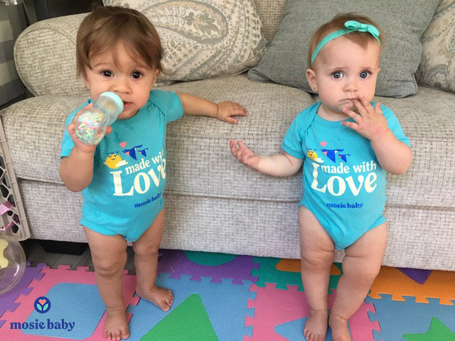 Mosie Baby twins in matching onesies