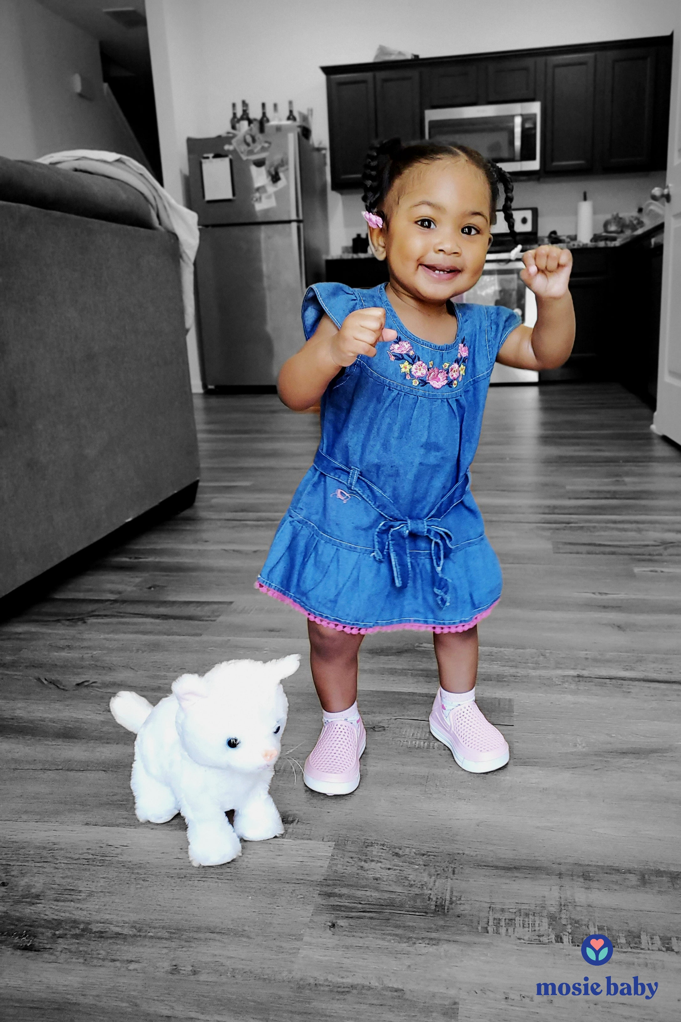 Young toddler standing with stuffed animal