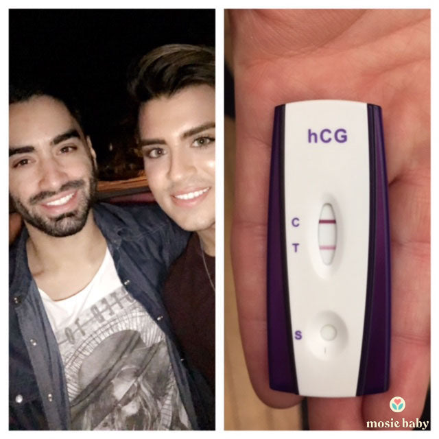 gay couple with a positive pregnancy test