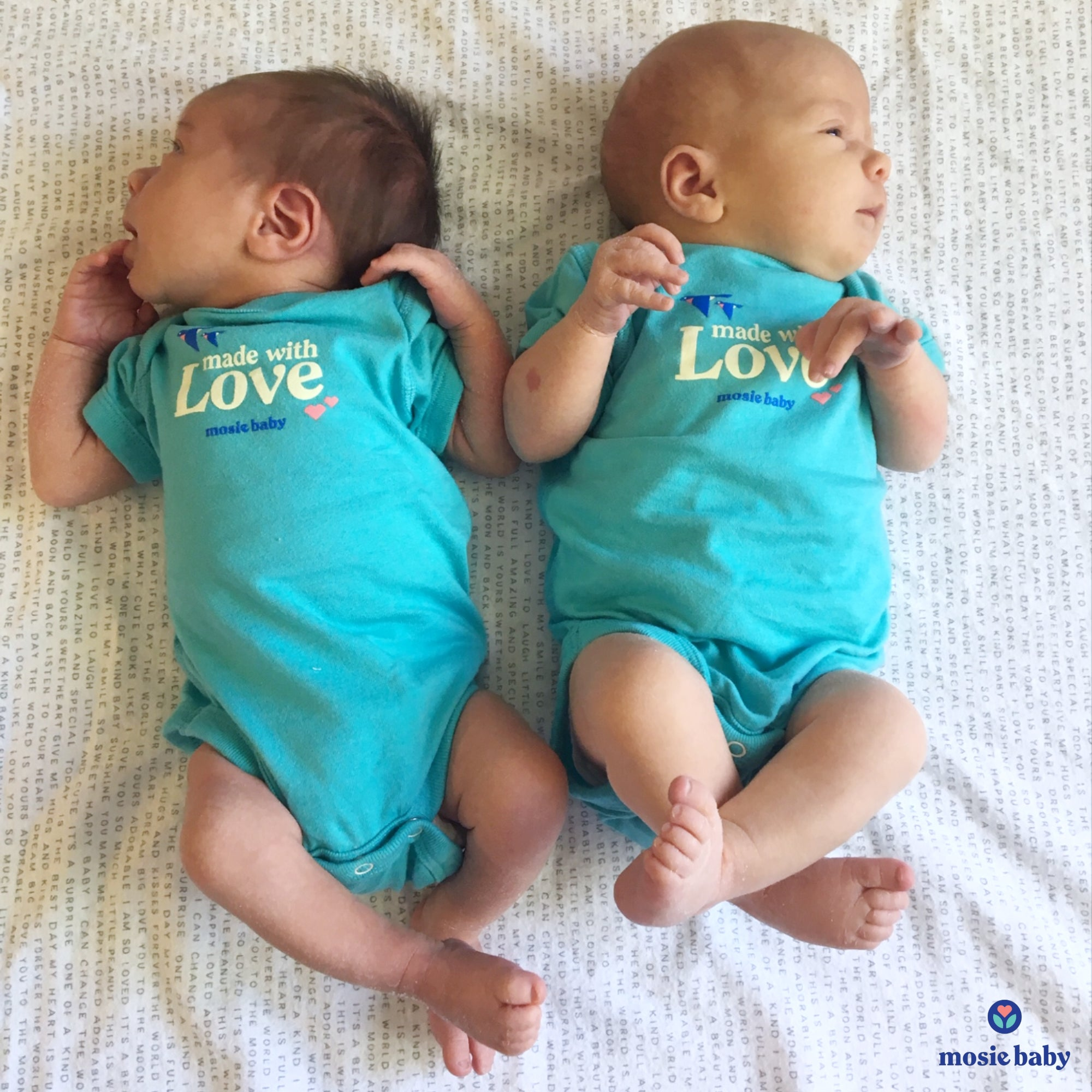 twin mosie babies in the mosie baby onesie