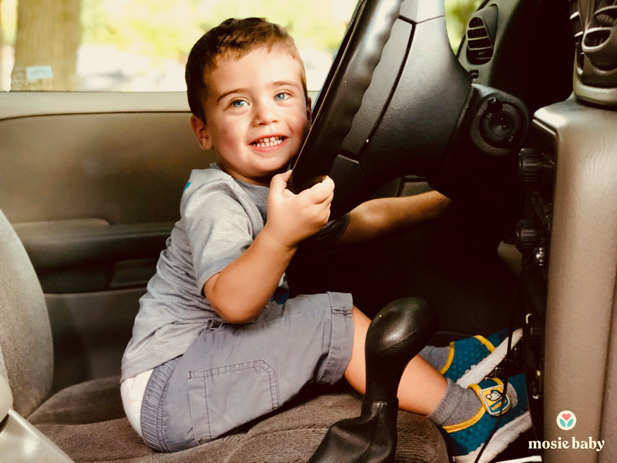 The first mosie baby Frank pretending to drive a car