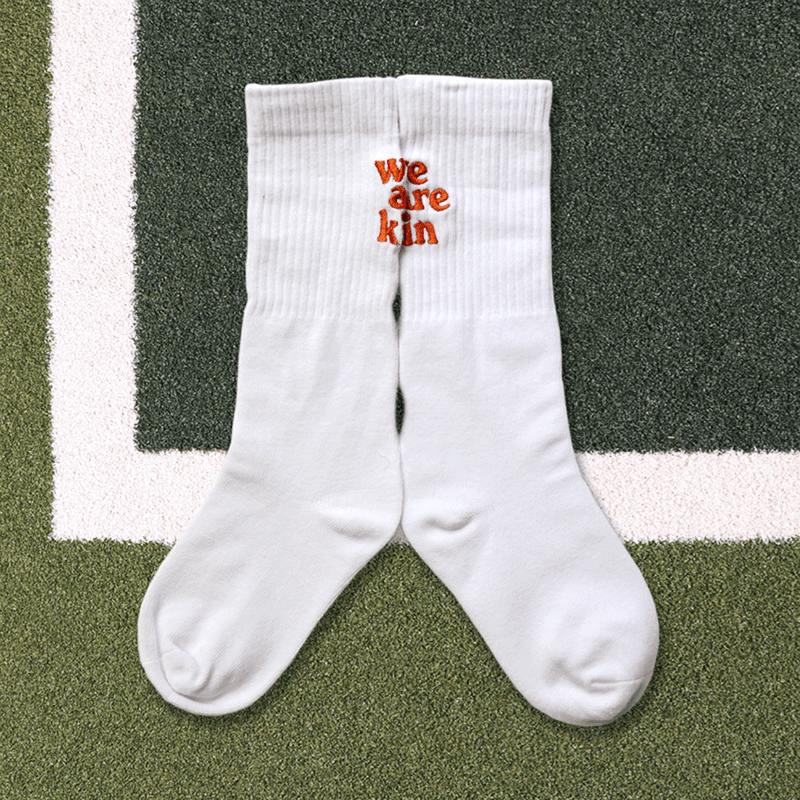 we are kin crew sock in white/orange