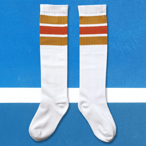 we are kin knee sock in white/oranges