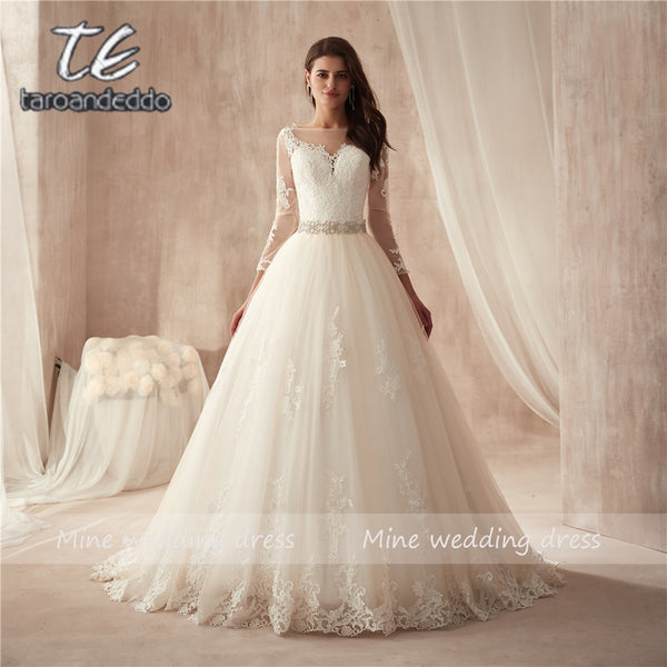 f727d2fd66be9 Sheer Crew Neck Sexy See Through Button Back Long Sleeves Appliques Vintage  Lace Wedding Dresses Vestios
