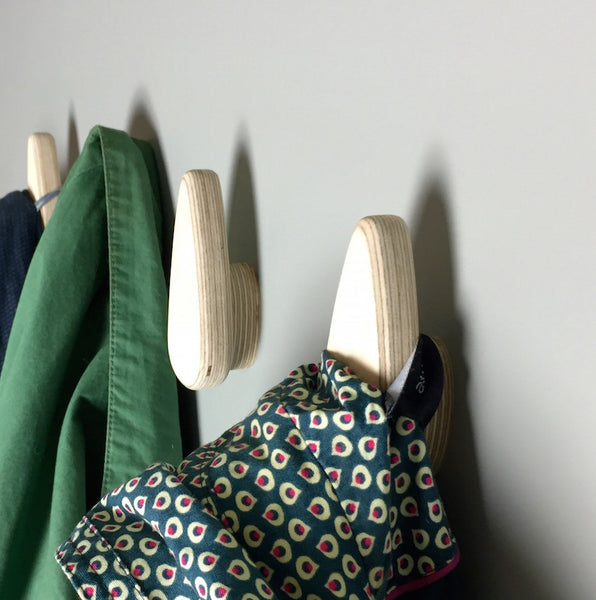 Smooth and tactile designer coat hooks