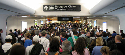 5 Ways To Avoid Crowds When You Travel baggage claim crowd