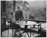 Millard Sheets and his wife sitting at a chess table made by Sam Maloof