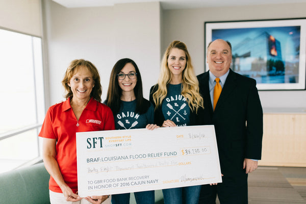 SFT donates money to the Greater Baton Rouge Food Bank