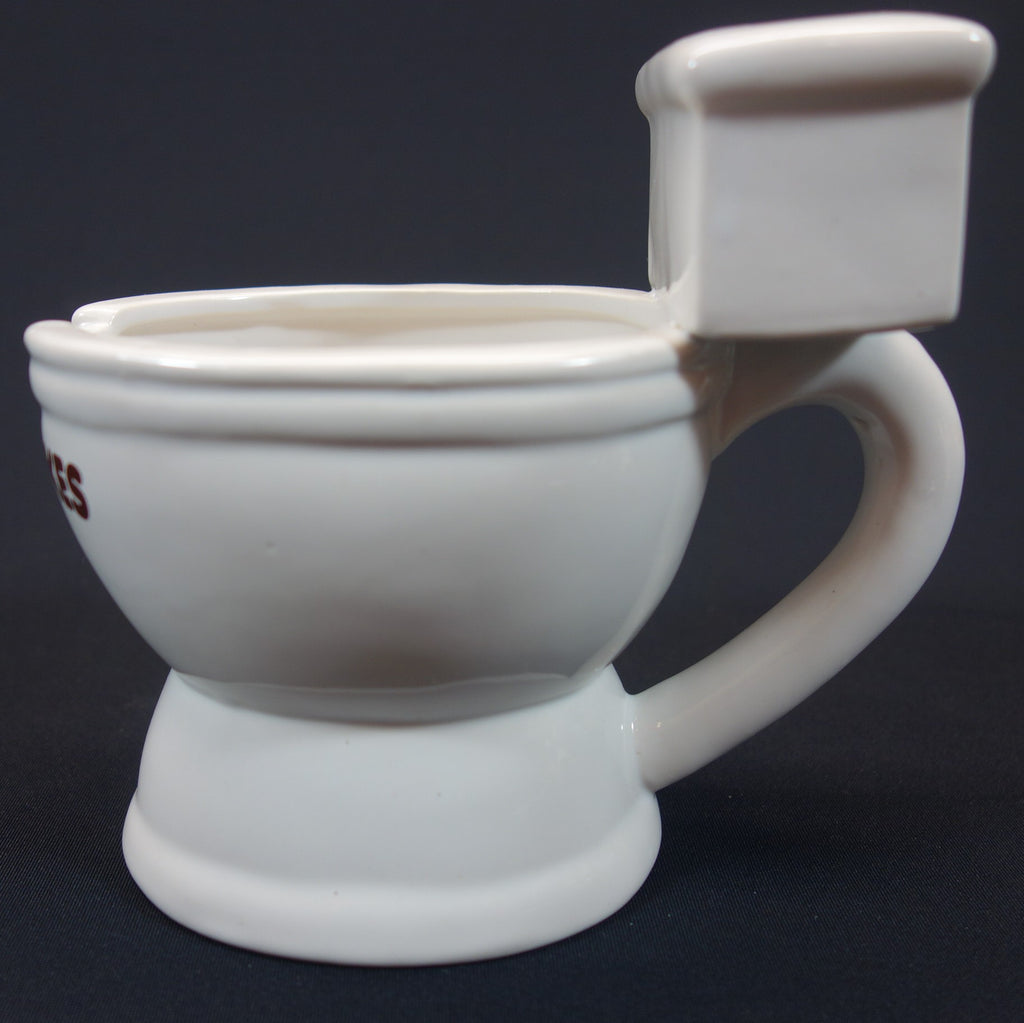 Side view of coffee mug shaped like a toilet