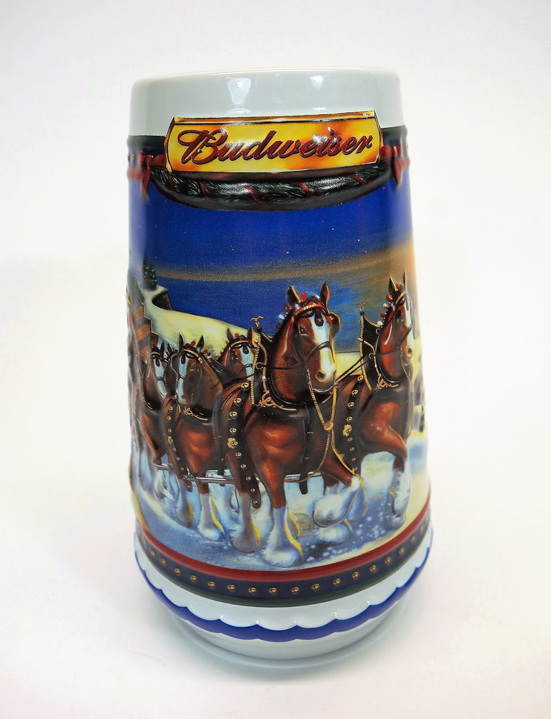 "Front view of holiday Budweiser beer stein night winter scene team of horses with title ""Budweiser""at the top"