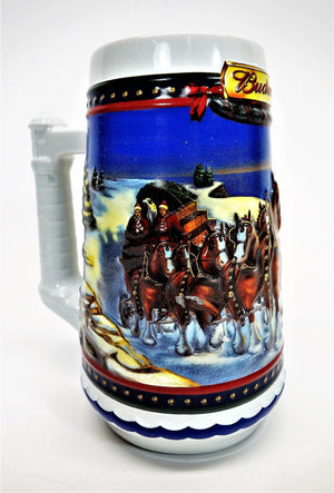 Front right side view of holiday Budweiser beer stein night winter scene team of horses pulling loaded wagon with two people