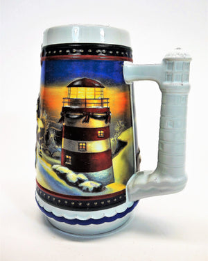 Left side view of holiday Budweiser beer stein night winter scene glowing lighthouse with holiday decorations
