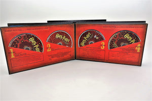 Album opened to Philosopher's Stone page and four discs