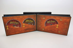 Album opened to Order of the Phoenix page and three discs