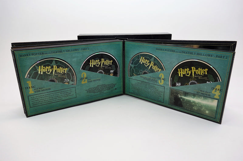 Album opened to Deathly Hallows-Part 2 page and four discs